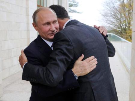Putin Assad hug